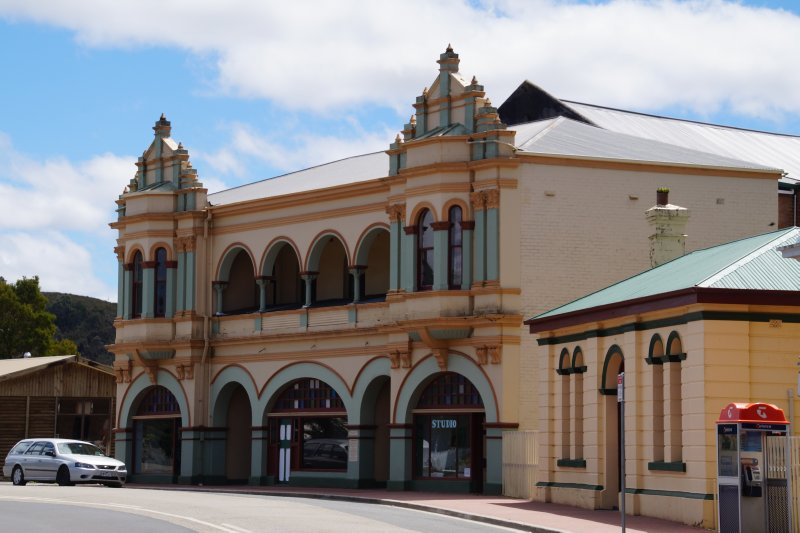 Zeehan Gaiety Theatre and Police Station with Court House behind
