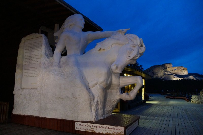 Scale model of Crazy Horse with mountain in background