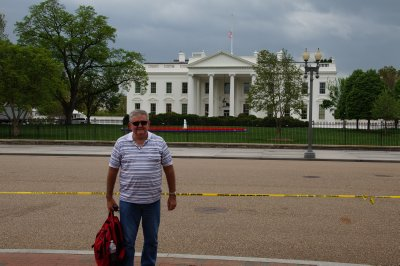The White House north view (Pennsylvania Avenue is closed to traffic in front of The White House) with a person of no fixed abode in the foreground