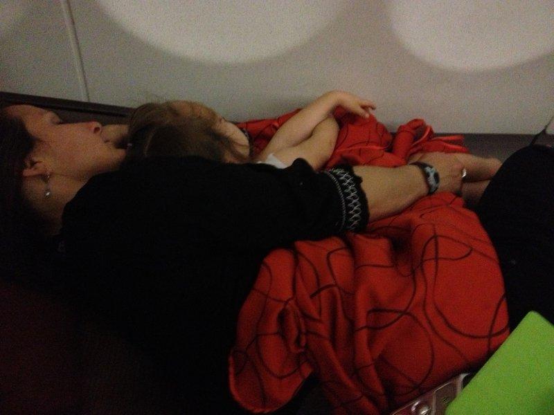 Asleep, lying down, in an airplane.  Pretty cush.