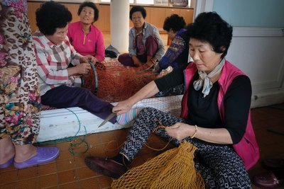 Haenyeo mending their nets