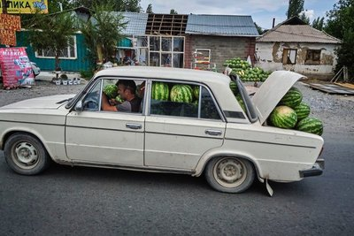 A man hauling watermelons
