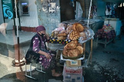 A woman selling bread on the road between Osh and Sulukta