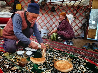 Having tea with a local family in their yurt