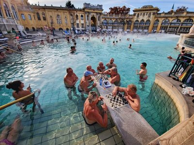 Men playing chess in the water at Szechenyi Baths
