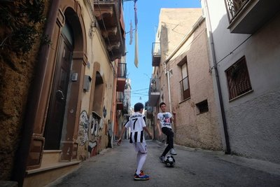 and kids playing football in Caltagirone.