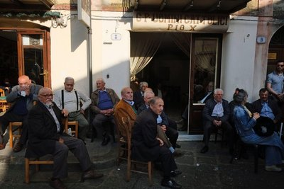 Local men sitting at a cafe in Castlebuono