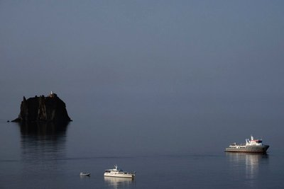 Cruising near Stromboli with Strombolicchio lighthouse in the distance