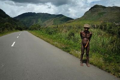 Dani tribesman on the outskirts of Wamena, Papua