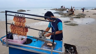 Grilling squid on the beach in Hua Hin