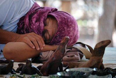 Saleswoman napping, Komodo island