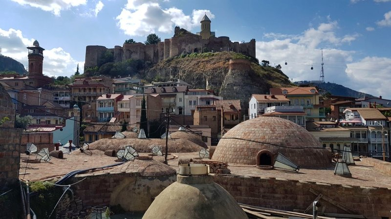 Domes of the Royal (sulphur) Baths with  (4th c.) Narikala Fortress in the background