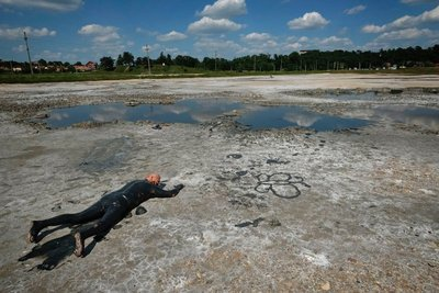 Man covered in therapeutic mud, Turda