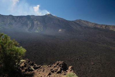 Lava field with Mt. Etna in the background