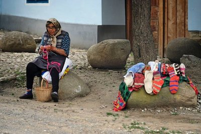 Roma woman knitting socks, Viscri