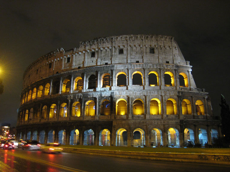The Colosseum on a rainy night in Rome, Italy