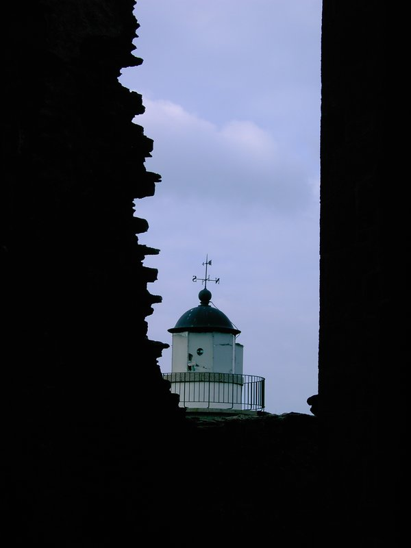 Old church and a lighthouse in St. Mathieu (Bretagne)
