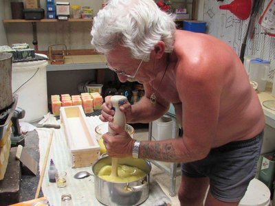 Al shows us how to mix and churn the combo with caustic soda and water