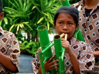 Bamboo flute player.. or is that a Tuba