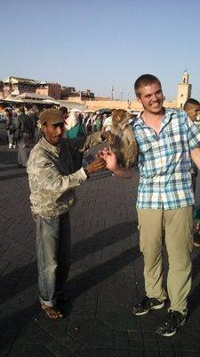 Ben touching another man's monkey