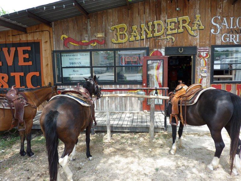 Horses in front of saloon, Bandera, Texas
