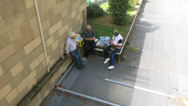 Elderly gentlemen enjoying a picnic