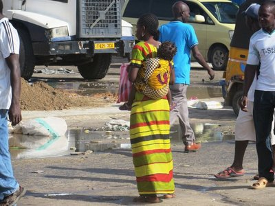 On the road through Dar es Salaam: beautiful bright colours and a baby on the back