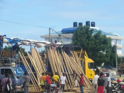 Timber for sale on the road side, through Dar es Salaam
