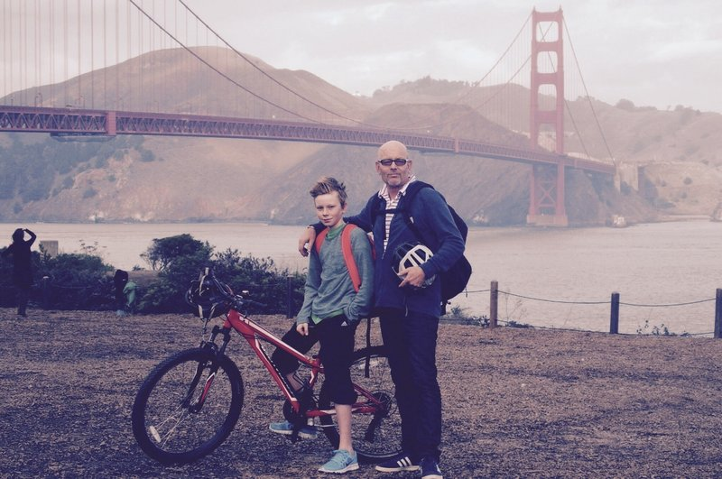 Family bike road over Golden Gate Bridge to Sausalito