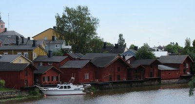 Riverside buildings originally painted with ochre to impress the King of Sweden