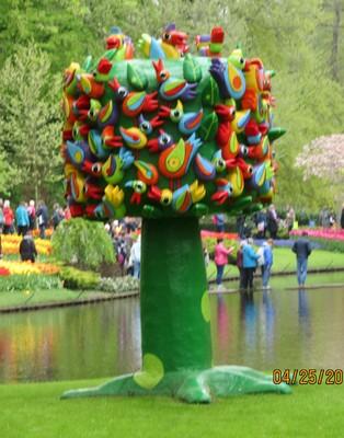 Whimsical tree full of birds - part of the garden art