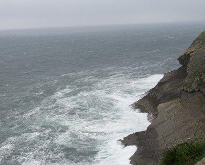 The waves crashing on the rocks