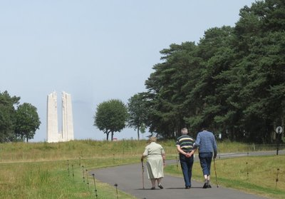Elderly walking toward the monument