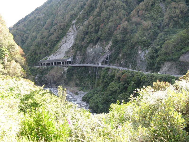 Otira Gorge Road showing rock shelter and Reid Falls
