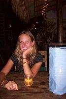 jenny enjoying a beaker f cambodian wine