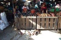 unfortunate chickens at a market in Phnom Penh