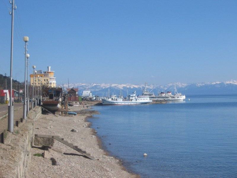 Listvyanka - Village, with snow capped mountains across Lake Baikal