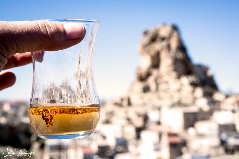 Just a glass of apple tea with a stunning view of cappadocia