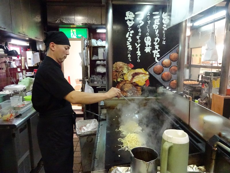 Cooking Okonomiyaki and Takoyaki, Japanese restaurant, Kyoto