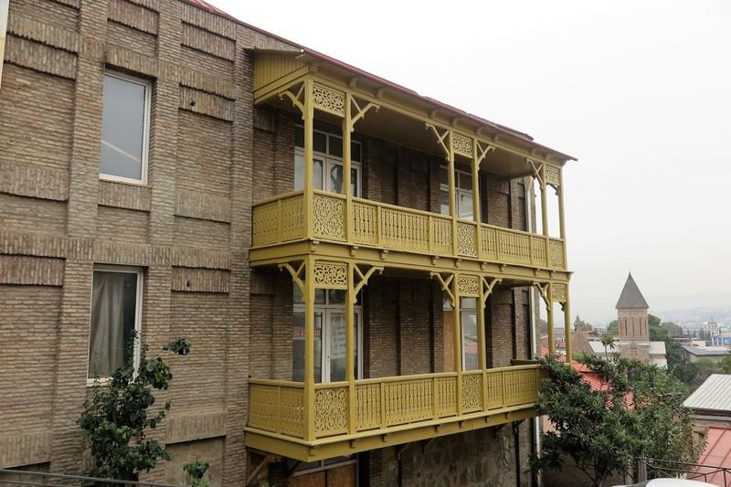 Wooden balcony railings of various designs