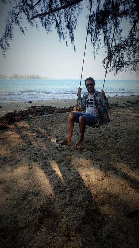 Jack swinging on the Laem Son beach swing