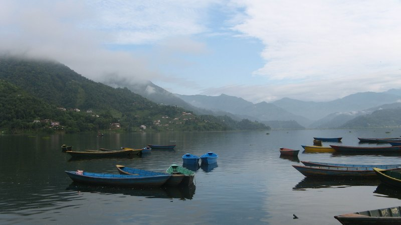 Paradise - boats floating on the Fewa Tal, early morning in Pokhara