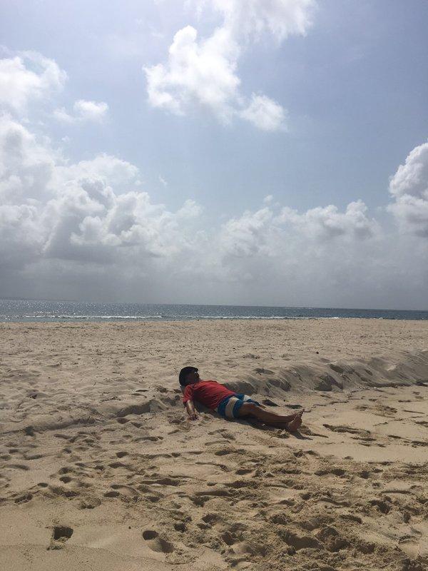 large_Neil_Asleep_on_beach.jpg