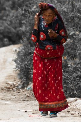 Old woman carring
