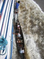 Kids climbing onto the boat