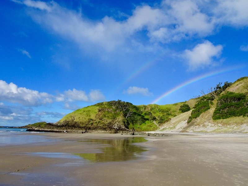At the end of Whangarei Heads,  lies the 3 mile long Ocean Beach and on this day, a couple of rainbows.
