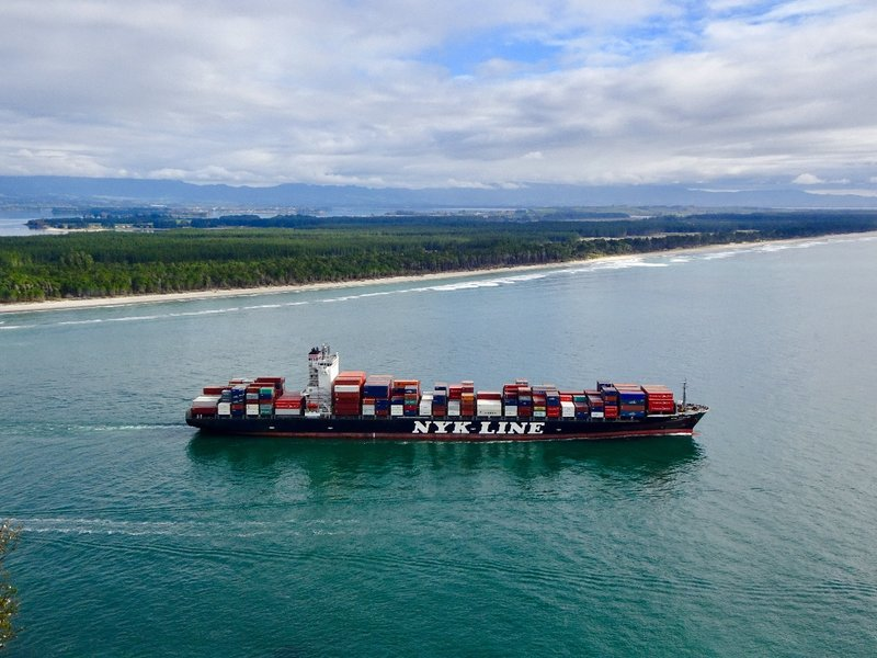 """The Port of Tauranga is located on the west side of the peninsula. During our climb up the """"Mount,"""" we saw this ship leaving the harbor and heading out into the Bay of Plenty"""