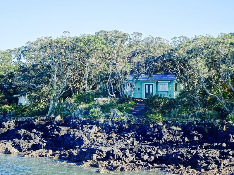 These baches (holiday beach homes) were built on Rangitoto in the 1920's and 30's for private use. By 1937, further building on the island was prohibited. There were once 140 baches, but now only 34 remain; basically, once a lease ran out, it was torn down. Now that the historical significance is more apparent,  at least for now, the remaining baches will stay.