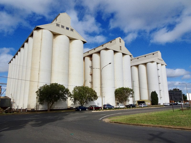 """The twin silos of the Peanut Company of Australia (PCA) in Kingaroy. Peanuts have been grown here since the 1920's PCA has developed a new breed of peanut called Hi oleic. These peanuts are higher in monounsaturated or """"good"""" oils and are said to stay fresh longer."""
