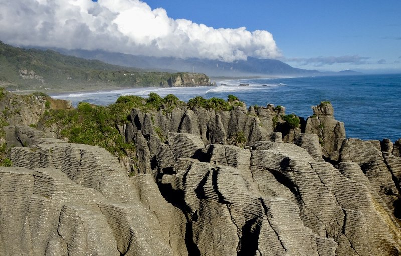 These are heavily eroded limestone rocks called the Pancake Rocks.